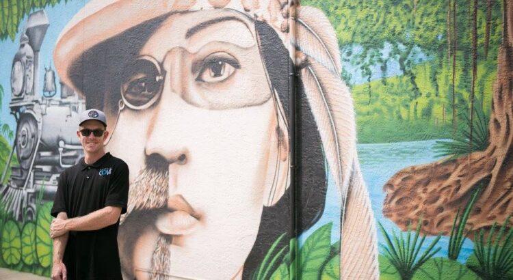 Derek Donnelly with mural photo